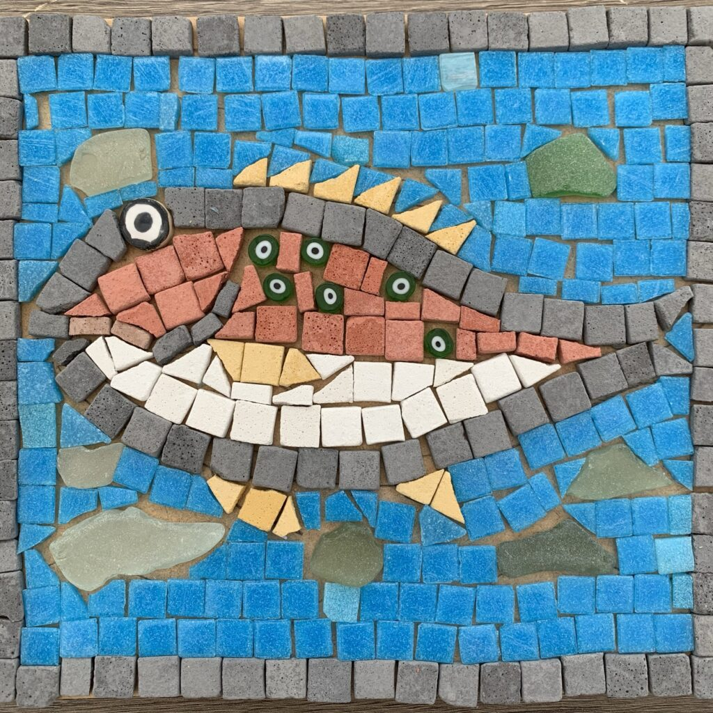Completed fish mosaic with seaglass background