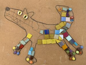 colourful mosaic of dog under construction